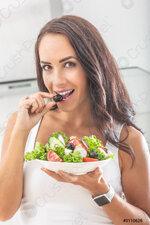 beautiful-woman-biting-into-olive-3110628.jpg